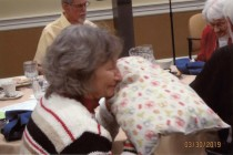 June Martin enjoying herb-fragranced pillow
